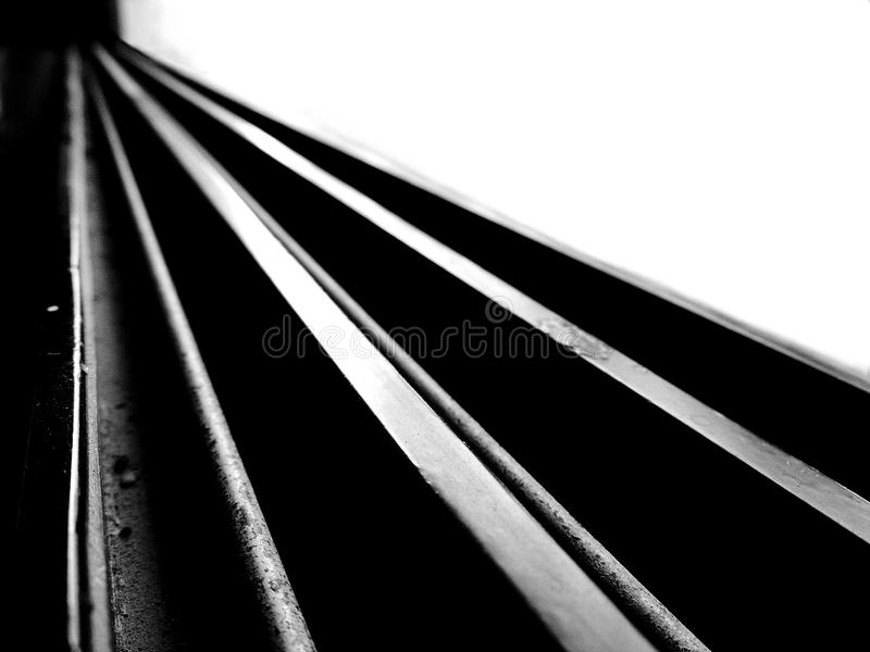 Black and white high contrast image of leading straight lines running diagonally stock photos