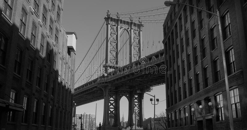 Black & White of The Iconic Manhattan Bridge Viewed From Dumbo, Brooklyn, USA. The Iconic Manhattan Bridge Viewed From Dumbo, Brooklyn, between two brick royalty free stock photos