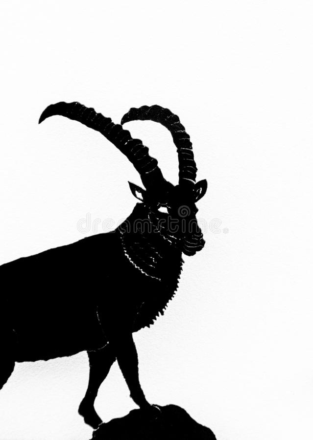 Black and white illustration of a mountain goat ibex in silhouette on a white background royalty free stock images