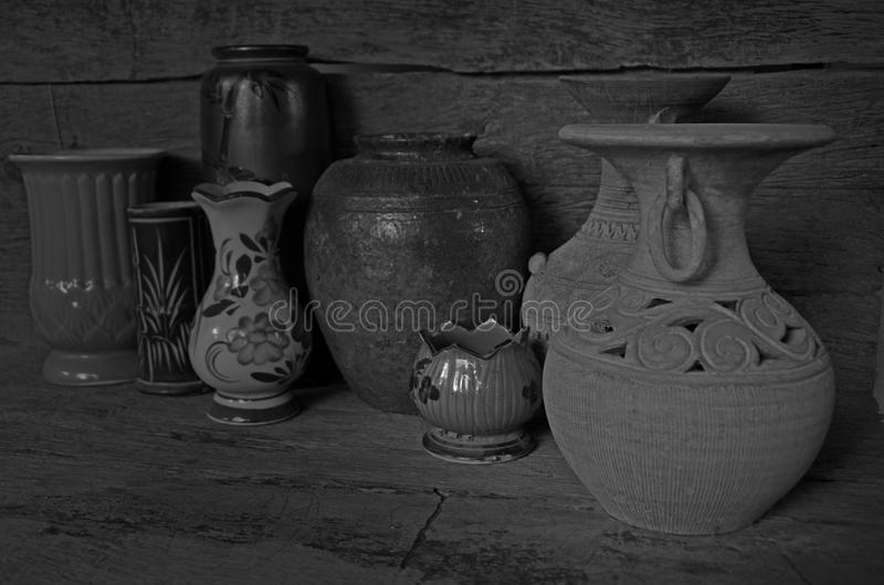 Black and white image of ancient new modern jars stock photos