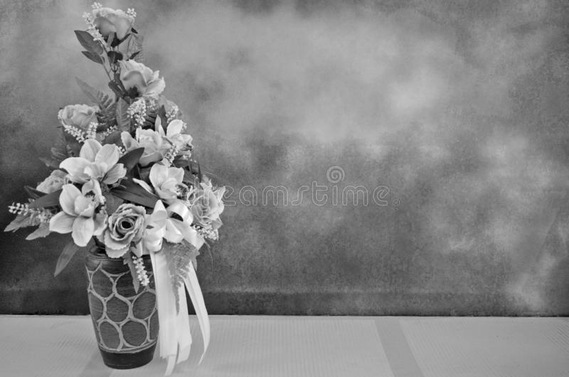 Black and white image of artificial rose vase. Black and white image of beautiful artificial rose and vase on the floor royalty free stock images