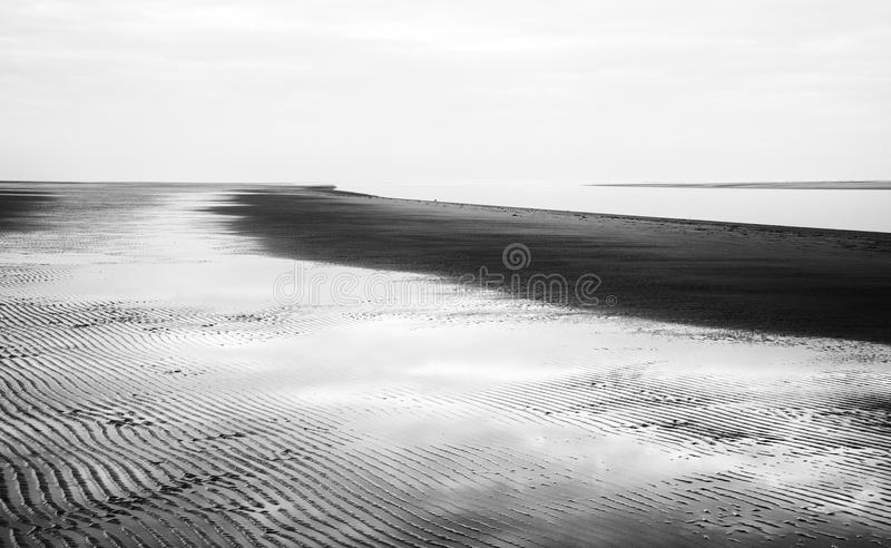 Black and white image of beach at low tide landscape royalty free stock images