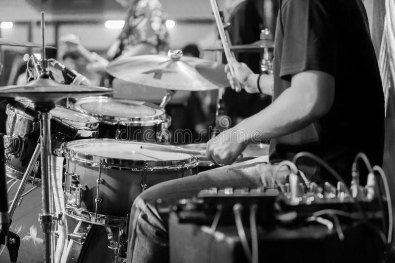 Black and white image of blurry hands movement of drummer with a drumsticks royalty free stock images