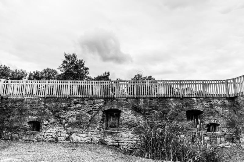 Black and white image of the brick walls in ruins with wooden railing of castle Schaesberg. Wonderful day in Landgraaf south Limburg in the Netherlands Holland royalty free stock images
