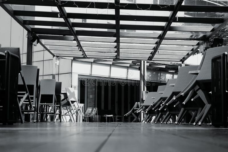 black and white image of chairs and table side near the pool.bright sunny day and shadow on wooden platform stock images