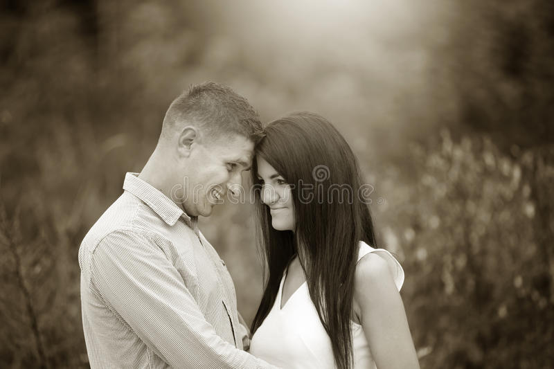 black and white image of a couple looking at each other royalty free stock photo