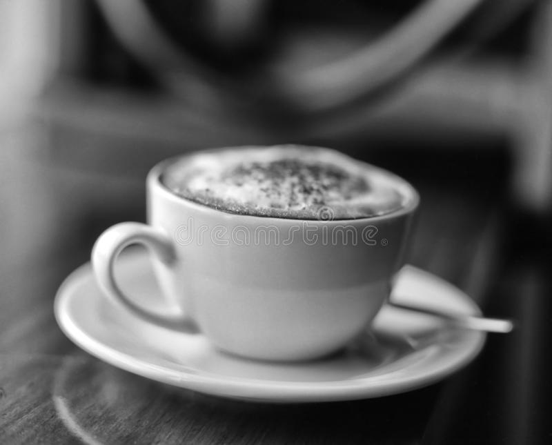 Black and white image of cup of cappuccino royalty free stock photos