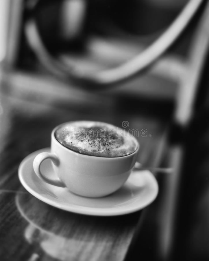 Black and white image of cup of cappuccino royalty free stock images