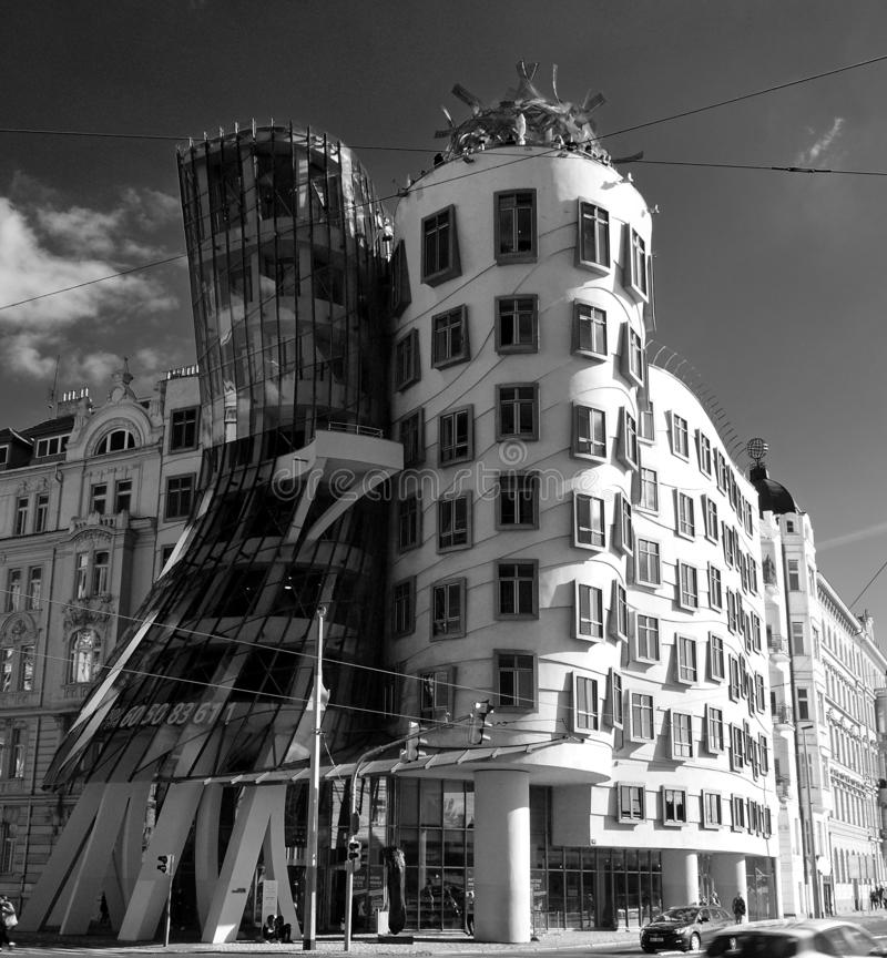 Black and White image of Dancing house by Frank Gehry in Prague. Dancing house by Frank Gehry in Prague. Dancing house or Fred and Ginger building in downtown stock photography