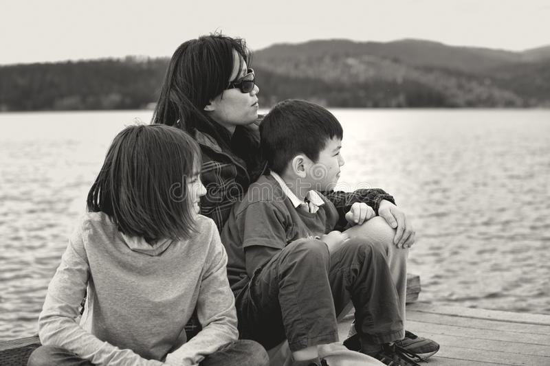 Mother and kids by the lake. stock images