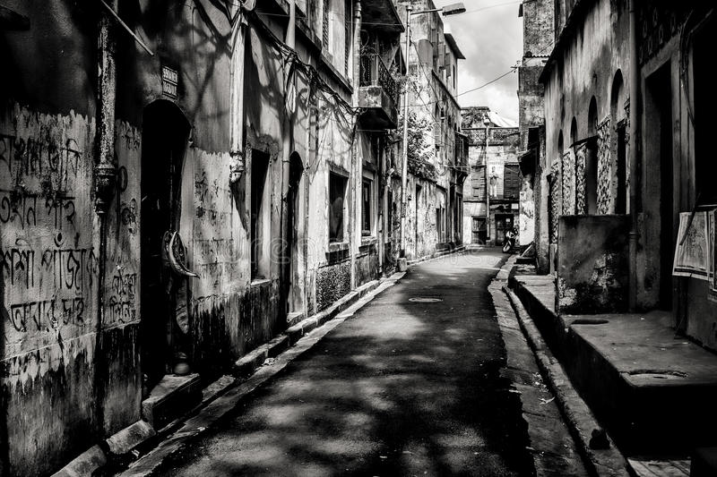 Download black and white image of a narrow street in kolkata editorial stock photo image
