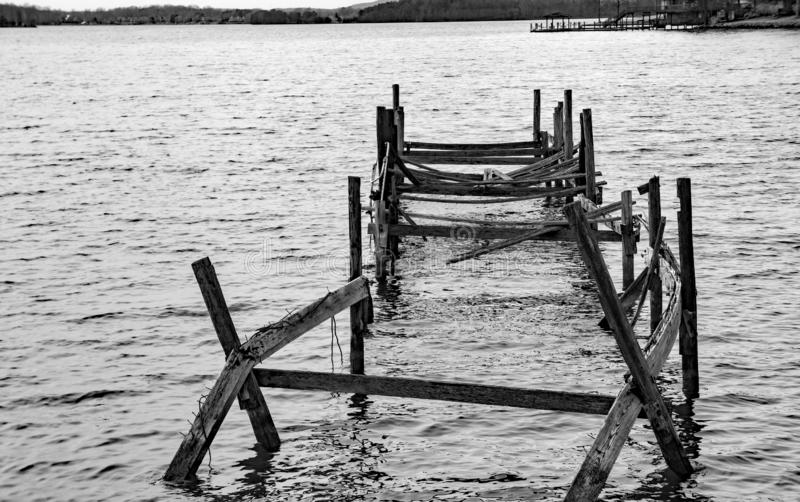 Old Abandoned Pier at Smith Mountain Lake. A black and white image of an old abandoned broken down pier located on Smith Mountain Lake, Virginia, USA stock photography