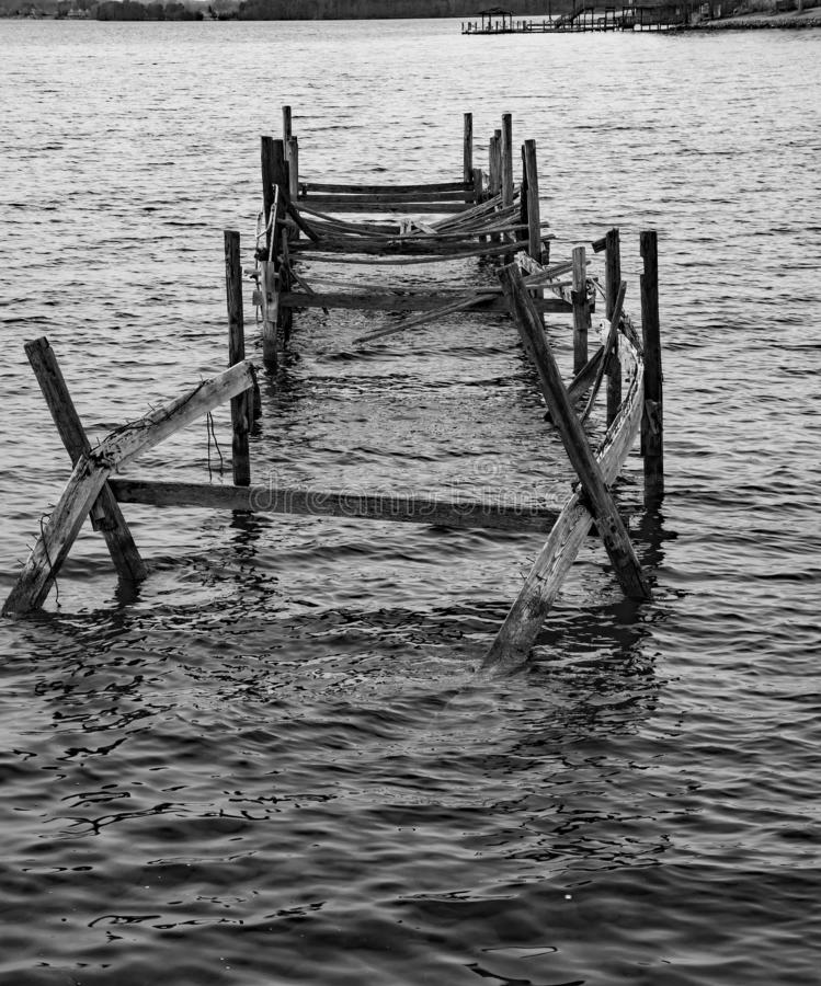 Old Abandoned Pier at Smith Mountain Lake - 2. A black and white image of an old abandoned broken down pier located on Smith Mountain Lake, Virginia, USA stock photo