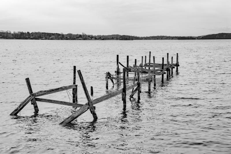 Old Abandoned Pier at Smith Mountain Lake - 3. A black and white image of an old abandoned broken down pier located on Smith Mountain Lake, Virginia, USA stock image