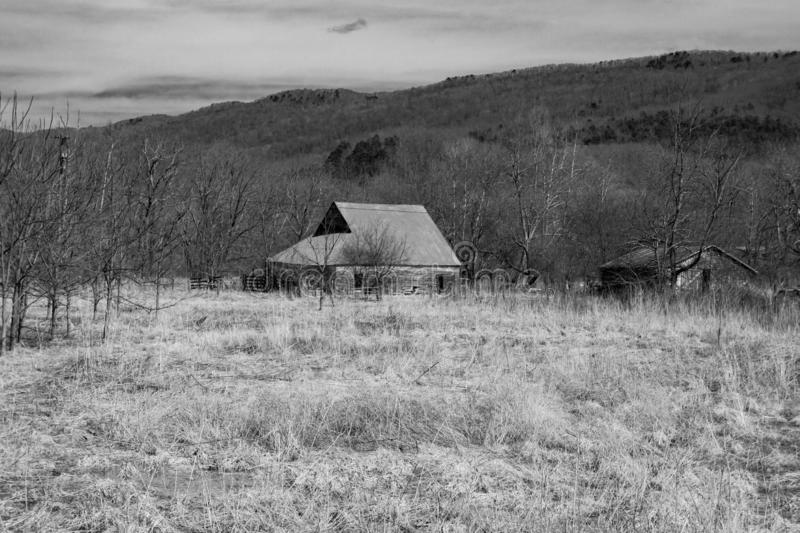 Rustic Old Barn in a Field. A black and white image of an old barn located in a field in Highland County, Virginia, USA stock images