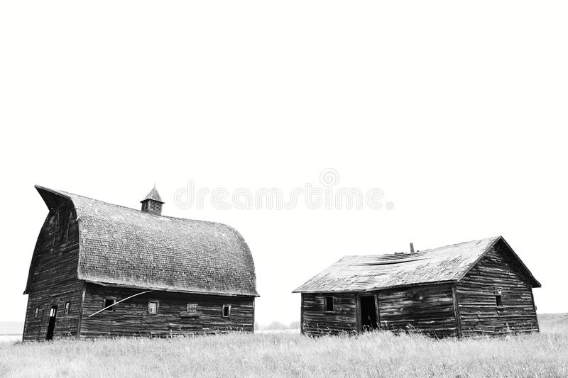 Old Run Down Buildings. A black and white image of old run down and abandoned farm buildings stock photography