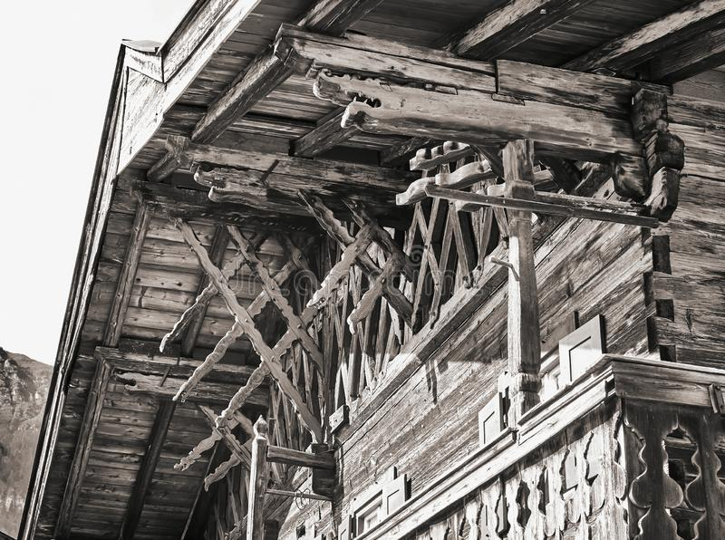 Black and white image of an old traditional Bavarian wood, upper part of the house royalty free stock image