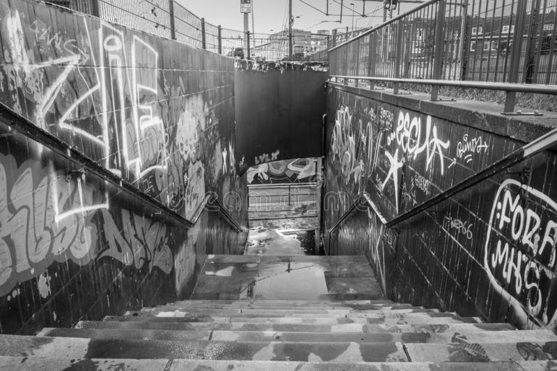 public pedestrian tunnel under the rail tracks in downtown Maastricht, the passage is full of graffiti stock images