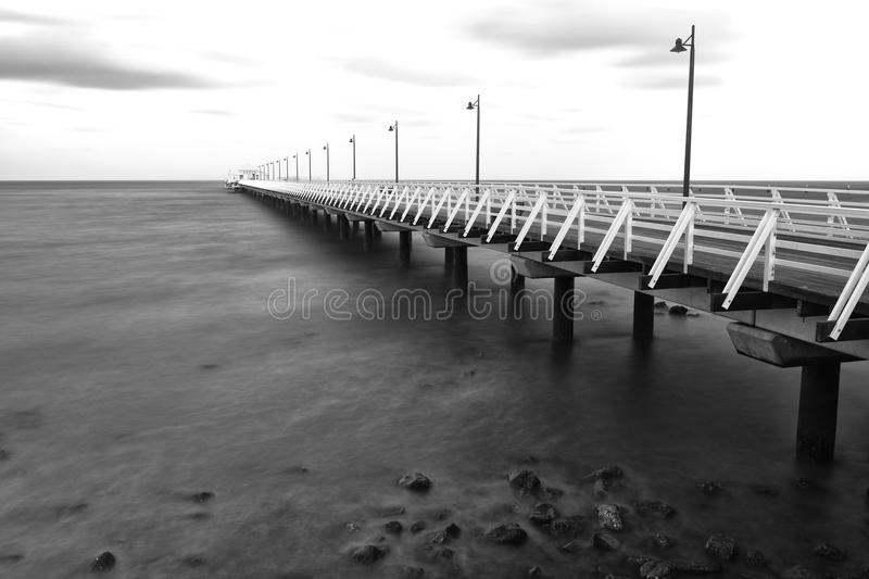 Black and white image of Shorncliffe Pier. In Queensland, Australia stock photo