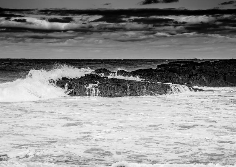 Black and White Image showing rolling waves at the Wild Coast of. The Indian Ocean at South Africa during summer royalty free stock photography