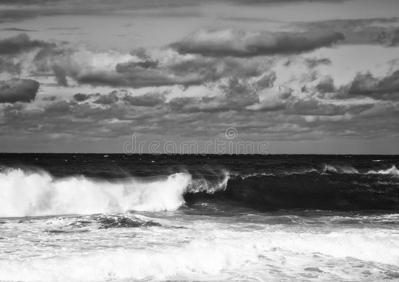 Black and White Image showing rolling waves at the Wild Coast of. The Indian Ocean at South Africa during summer stock image
