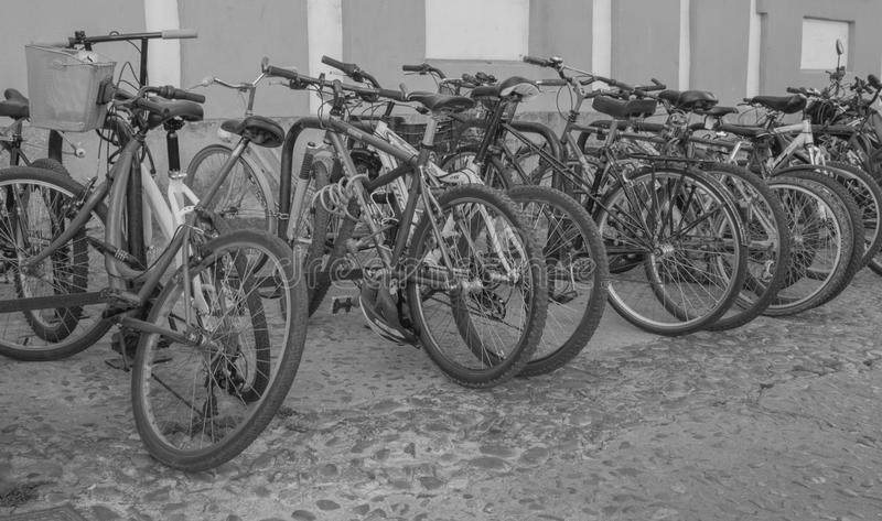 Black and white image of some bicycles parked on the street royalty free stock photography