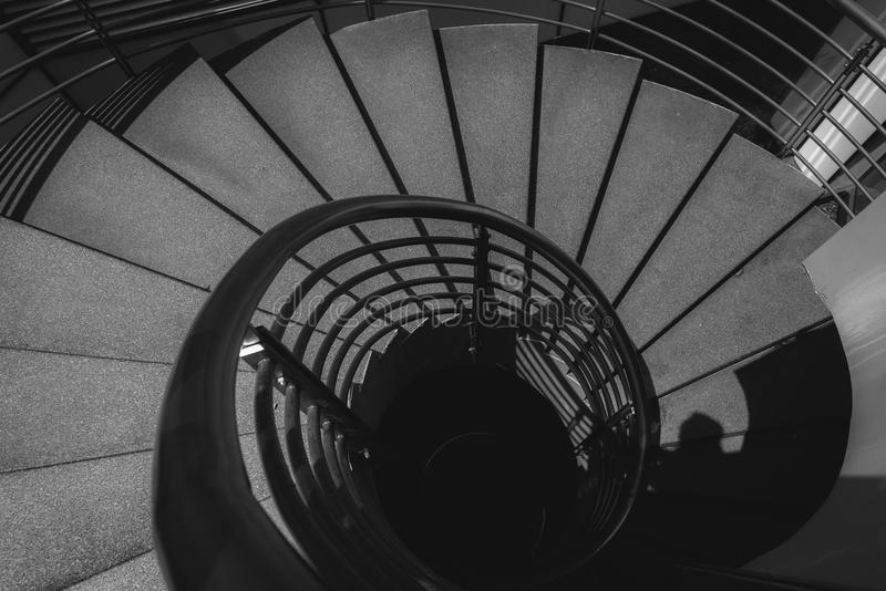 Black and white image of spiral staircase. stock photography