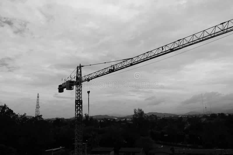 Black and white image of Tower crane silhouette construction with heavy industrial royalty free stock photography