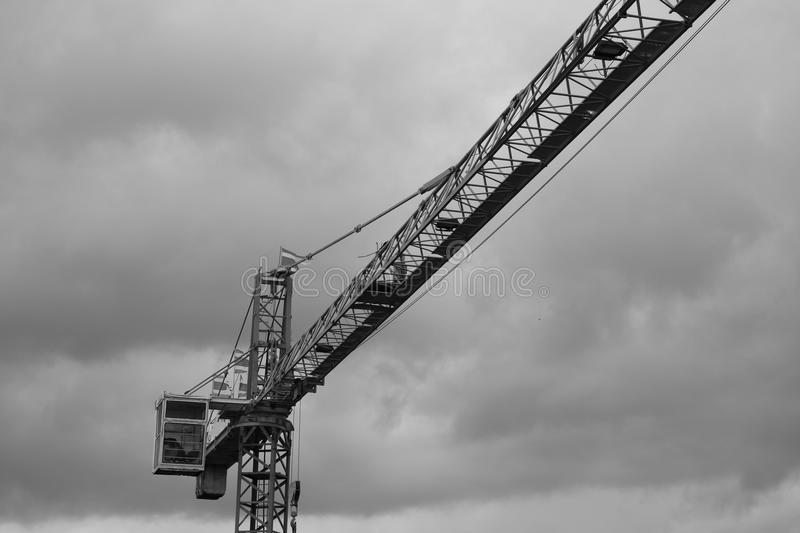 Black and white image of Tower crane silhouette construction with heavy industrial royalty free stock photos