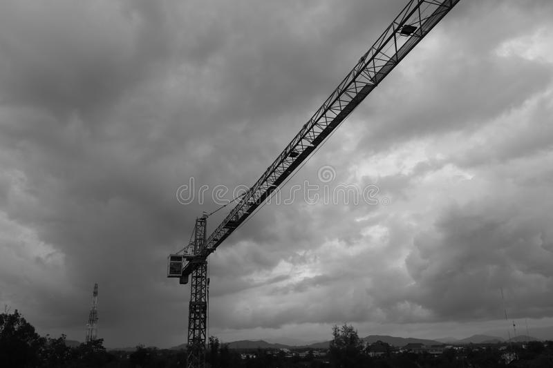 Black and white image of Tower crane silhouette construction with heavy industrial stock images