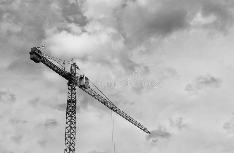 Black and white image of Tower crane silhouette construction with heavy industrial stock photos