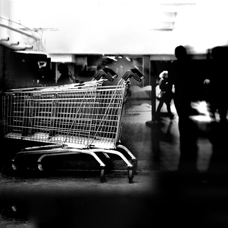 Chrome shopping carts. Black and white image of two chrome shopping carts stock image