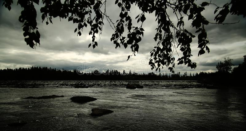 Black and white image of view over Angerman stream in Vilhelmina, Sweden.  stock photo