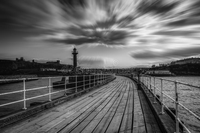 Black and white image of Whitby pier royalty free stock photos
