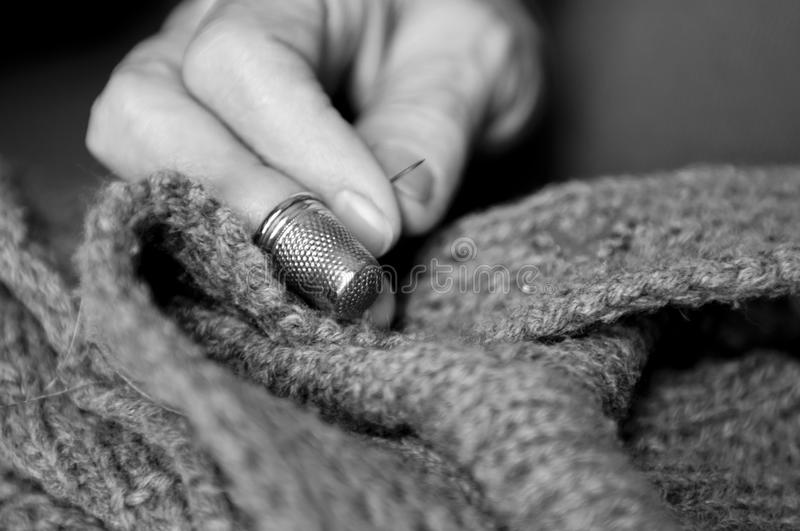 Black and white image of woman sewing stock photos
