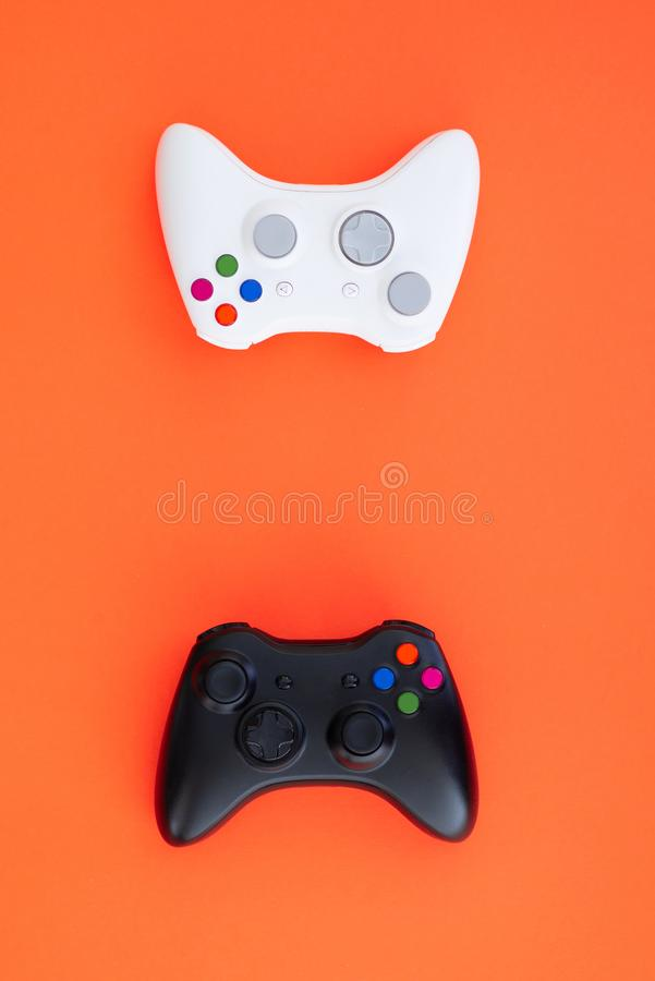 Black and white joystick on a red background. White and black gamepad is isolated on a red background royalty free stock images