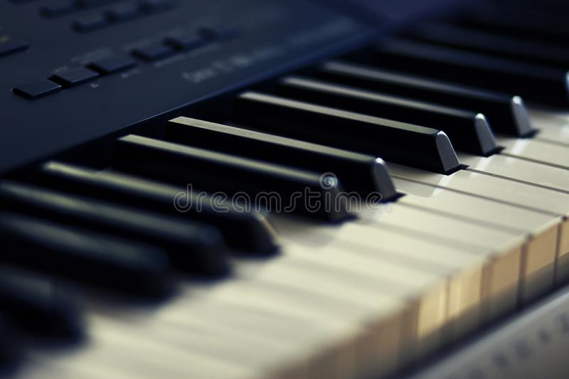 Black and white keys of modern musical instrument-synthesizer stock images