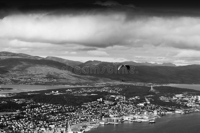 Black and white kite flyer above city background. Hd royalty free stock photos