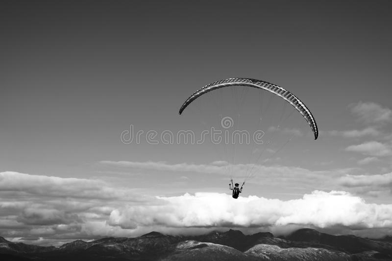 Black and white kite flyer in the sky background. Hd royalty free stock image
