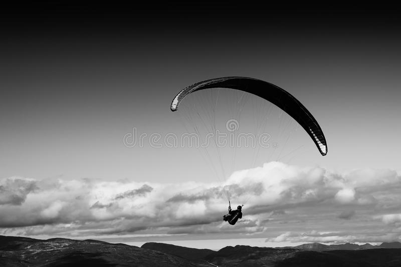 Black and white kite flyer in the sky background. Hd royalty free stock photography