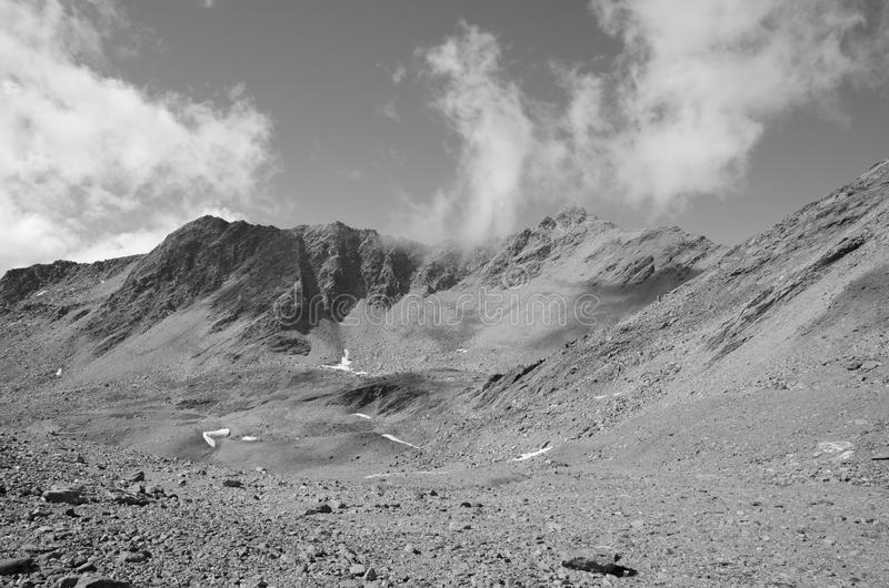 Black and White Landscape with Mountains and Clouds stock photography