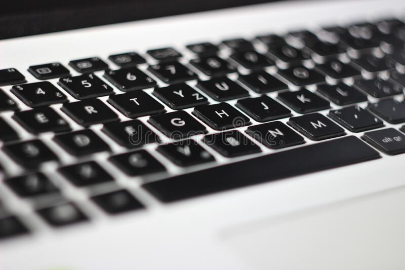 Black and white laptop keyboard. Detail of black and white  laptop keyboard, details of letters, business detail stock images