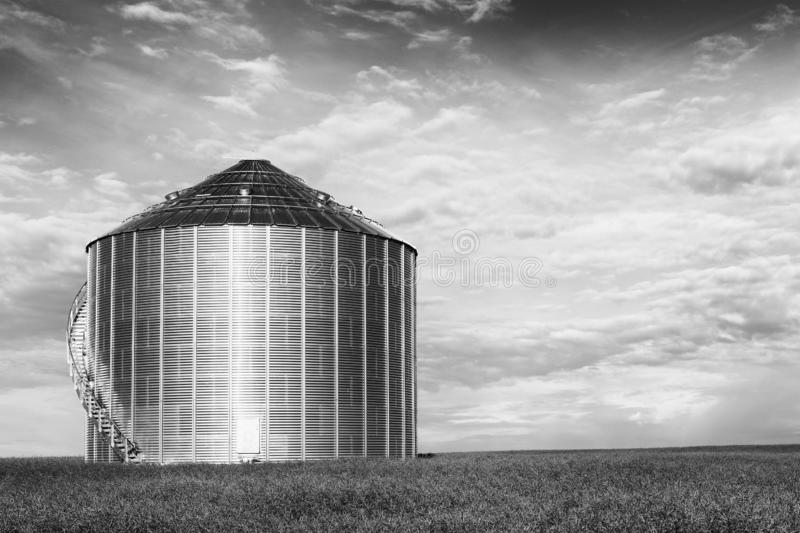 Black and white of large grain bin Saskatchewan, Canada. A Black and white of large grain bin Saskatchewan, Canada stock image