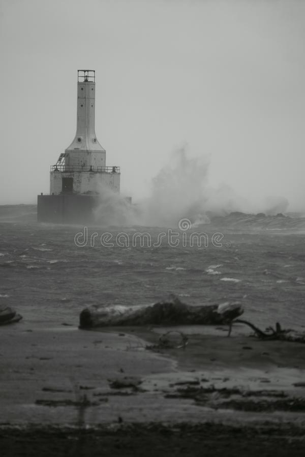 Black And White Lighthuse In a storm. This black and white picture of the lighthouse in Mclain State Park, was taken on 10/12/17, during a huge wind storm that stock photo