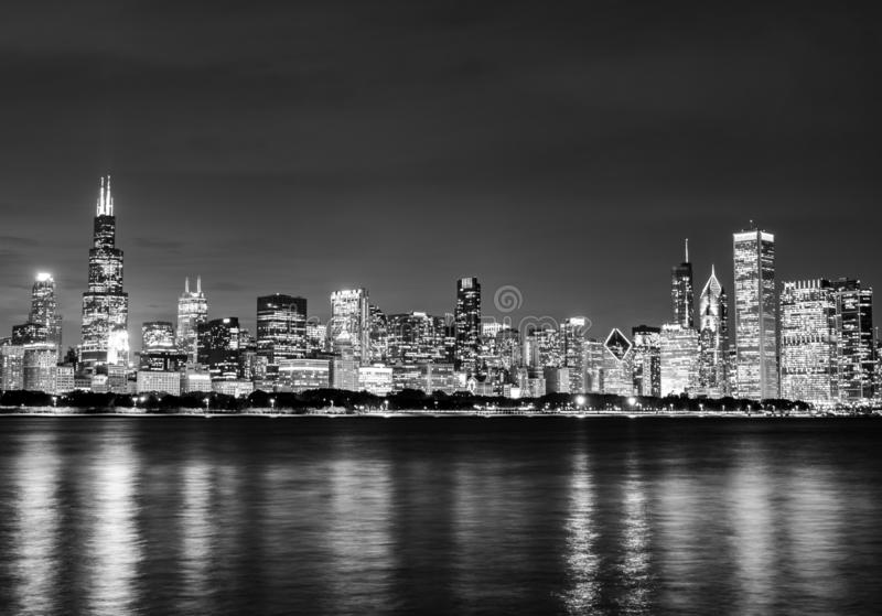 Black and White Chicago Skyline at Night. A black and white long exposure image of the Chicago skyline and Lake Michigan at night royalty free stock images