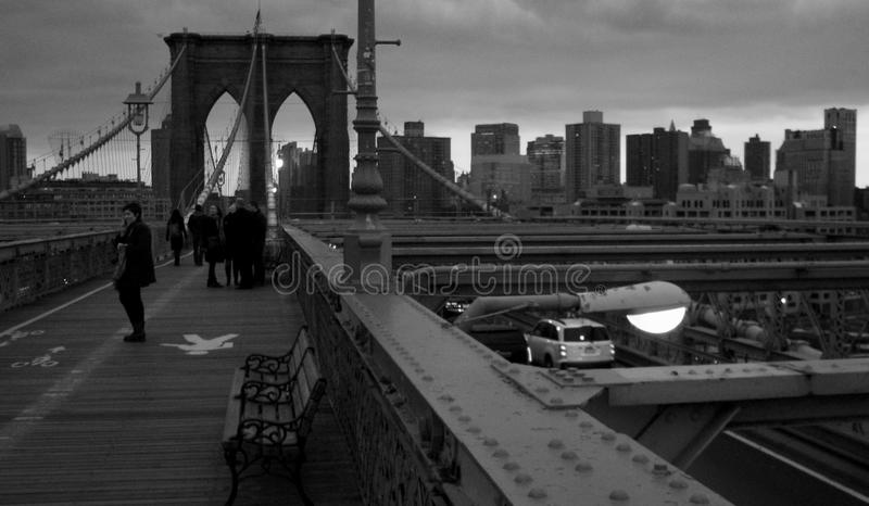 A black and white look at the Brooklyn Bridge looking onto Manhattan - USA royalty free stock photos