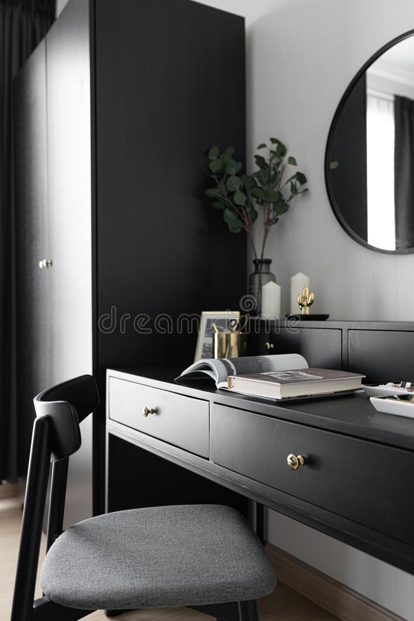 Black and white luxury feel dressing table corner in modern scandinavian style with gold circular lamp decorated / interior design. Concept / scandinavian royalty free stock image