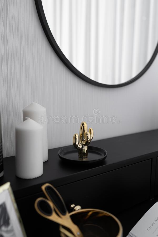 Black and white luxury feel dressing table corner in modern scandinavian style with gold circular lamp decorated / interior design. Concept / scandinavian royalty free stock photography
