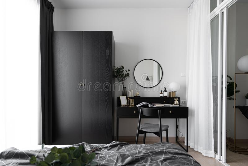 Black and white luxury feel dressing table corner in modern scandinavian style with gold circular lamp decorated / interior design. Concept / scandinavian stock images