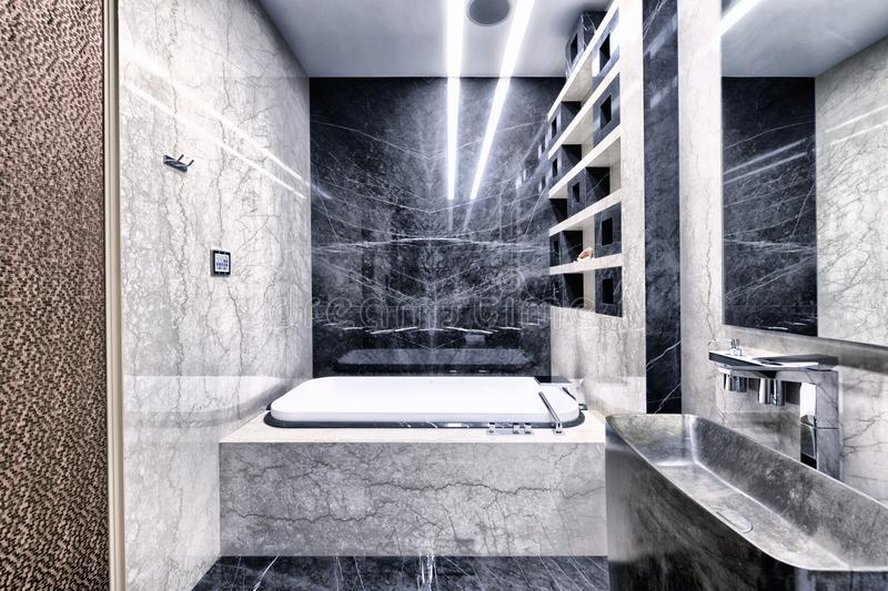 Black-and-white marble in the interior of a modern bathroom in a luxury apartment. Russia,Moscow region - bathroom interior in new luxury house royalty free stock images